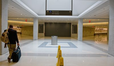 A proposed below-ground Metrorail station at Washington Dulles International Airport would be located at the end of the corridor leading from daily parking garages 1 and 2. (Barbara L. Salisbury/The Washington Times)