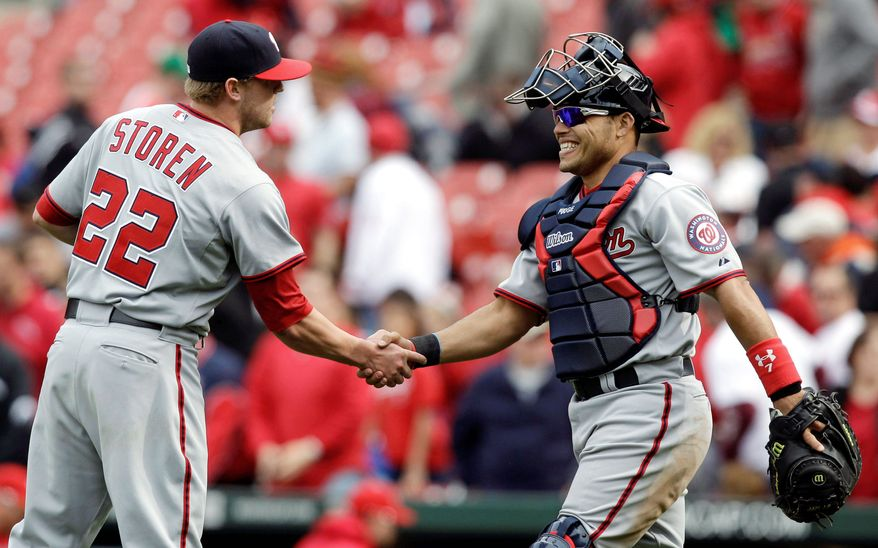 Washington catcher Ivan Rodriguez congratulates reliever Drew Storen after closing out the Nationals' 8-6 win over the Cardinals in the first game of a doubleheader. (Associated Press)