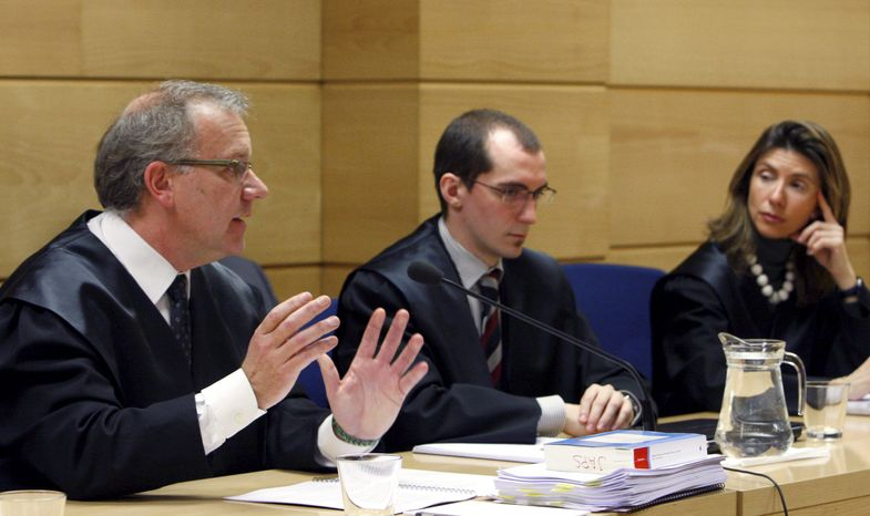 **FILE** In this Jan. 19 photo, Javier Aparicio (left), a lawyer representing Google, speaks during a court hearing in Madrid. Their ranks include a plastic surgeon, a prison guard and a high school principal. All are Spanish, but have little else in common except this: They want old Internet references about them that pop up in Google searches wiped away. (Associated Press)