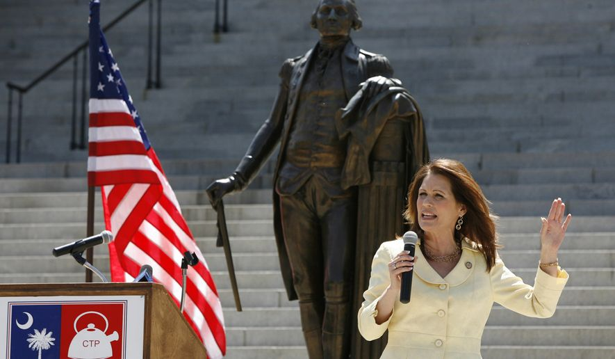 Michele Bachmann speaks Monday during a tea party rally at the State House in Columbia, S.C. Bachmann spoke at the rally after Gov. Nikki Haley told the crowd of about 300 people that they need to keep pressure on legislators, and tell them to wrap up work on a bill requiring voters to show photo identification when they head to the polls. Bachmann met with Haley before the rally. (Associated Press/The State)