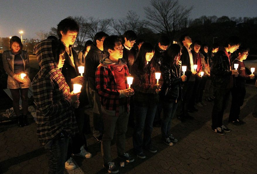 Students at the Korea Advanced Institute of Science and Technology light candles April 10 to mourn fellow students who committed suicide at their campus in Daejeon, South Korea. Four have killed themselves since the beginning of the year. (Associated Press)