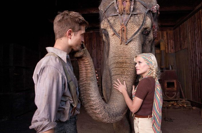 "Robert Pattinson and Reese Witherspoon's chemistry-free romance in ""Water for Elephants"" makes them mostly foils for the violently cruel circus owner who happens to be his boss and her husband. (Associated Press)"