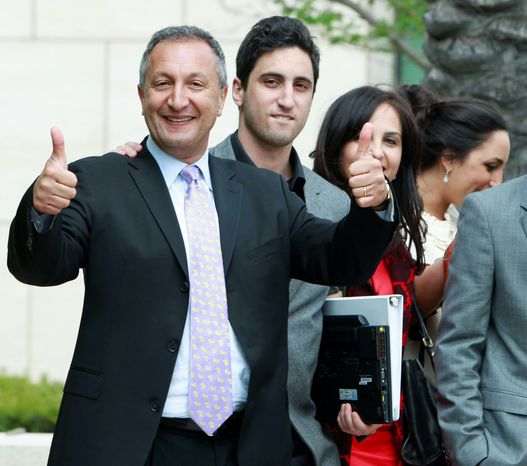 MGA Chief Executive Isaac Larian celebrates a victory over Mattel Inc. outside of federal court in Santa Ana, Calif., on Thursday. Mattel had contended that Bratz designer Carter Bryant created the line while employed by Mattel. (Associated Press)