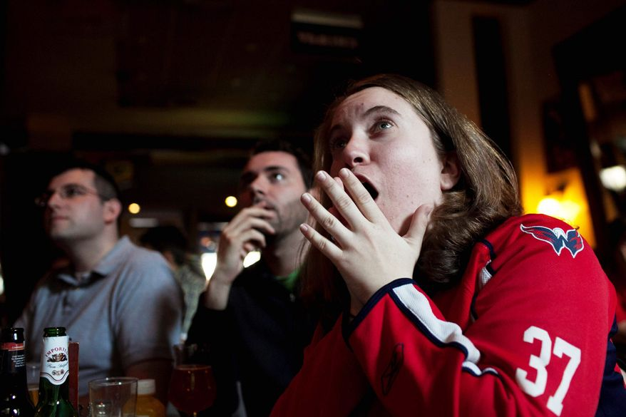 """Heather Gildon of Crystal City was at RFD Bar in Chinatown on Sunday to watch the Capitals, a game the home team to the New York Rangers in New York. The team will be back home at the Verizon Center on Saturday, a place described as """"electric for Capitals games."""" (Drew Angerer/The Washington Times)"""