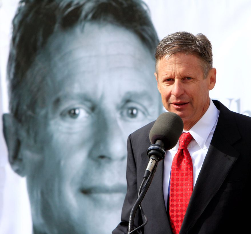 Former New Mexico Gov. Gary Johnson announces his plans to seek the Republican nomination for president in front of the Statehouse on Thursday in Concord, N.H. Mr. Johnson says he has the resume needed to lead the country. (Associated Press)
