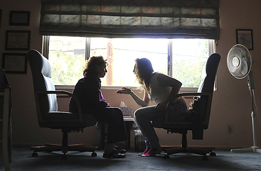 "Children of the Night resident ""Jane,"" 17, gets emotional with Family Therapist Dr. Helaine Harris during a therapy session in Harris' home in Los Angeles, Thursday, April 21, 2011. ""Jane,""  sees Harris every week to help her manage her emotions from her troubled past. (Garrett Cheen/Special to The Washington Times)"
