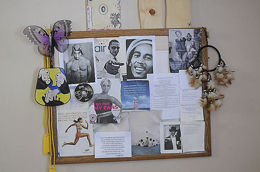 """""""Jane,""""  bulletin board in her bedroom is plastered with picures and poems of Bob Marley, Barack Obama, Tupac Shakur, Nancy Reagan and Mr. T, and other iconic people that have and continue to inspire her.(Garrett Cheen/Special to The Washington Times)"""