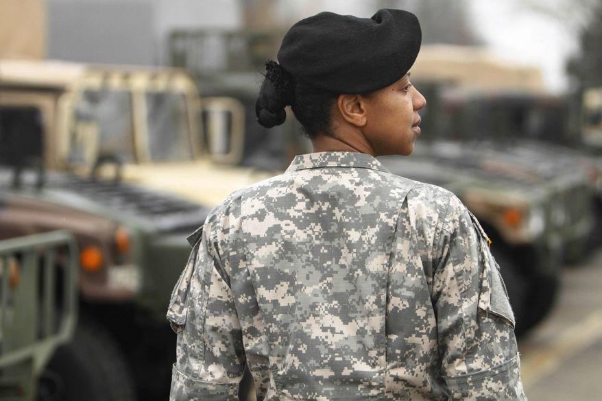 ** FILE ** Army Maj. Sequana Robinson models a woman's combat uniform on Saturday, March 31, 2011, at Fort Belvoir, Va. (Associated Press)