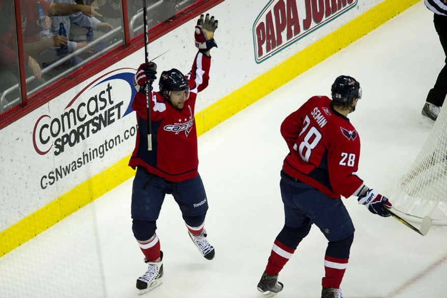 Capitals Mike Green throws up his hands after scoring a goal to put the Caps up 1-0 over the Rangers  during the first period of game five of the first round playoff series, at the Verizon Center in Washington, D.C., Saturday, April 23, 2011. (Drew Angerer/The Washington Times)