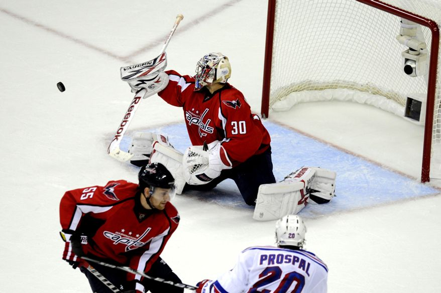 Capitals goalie Michal Neuvirth makes a stop in the third period during game five of the first round playoff series, at the Verizon Center in Washington, D.C., Saturday, April 23, 2011. (Drew Angerer/The Washington Times)