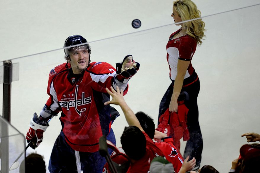 Alex Ovechkin flips a puck to the fans after the Capitals 3-1 win over the Rangers in game five of the first round playoff series, at the Verizon Center in Washington, D.C., Saturday, April 23, 2011. (Drew Angerer/The Washington Times)