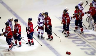 The Rangers and Capitals shake hands after the Caps eliminated the Rangers from the playoffs with their 3-1 win in game five in the first round playoff series, at the Verizon Center in Washington, D.C., Saturday, April 23, 2011. (Drew Angerer/The Washington Times)