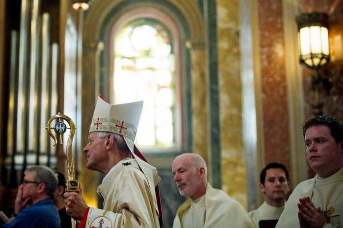 """Cardinal Donald W. Wuerl, the archbishop of Washington, urged Catholics to rejuvenate their faith and share it with others. """"We are not just bystanders. We're invited to share in Christ's new life,"""" he said. (Drew Angerer/The Washington Times)"""