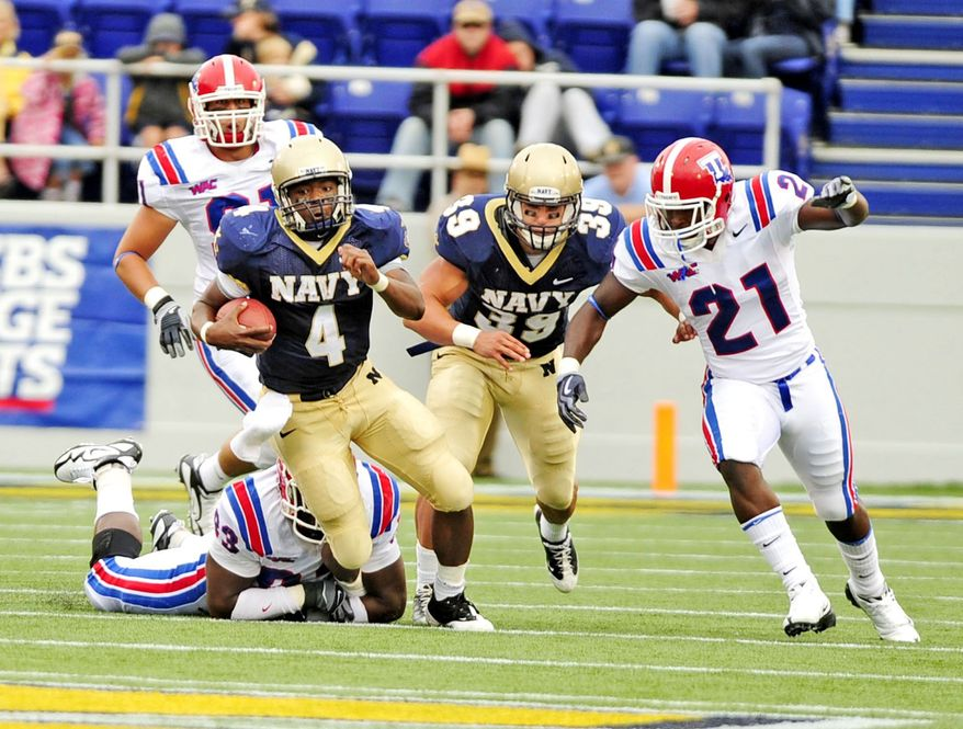 Quarterback Ricky Dobbs (4) finished his Navy career as the school's all-time leader in touchdowns (49) and fifth in rushing yardage (2,665). (The Washington Times)