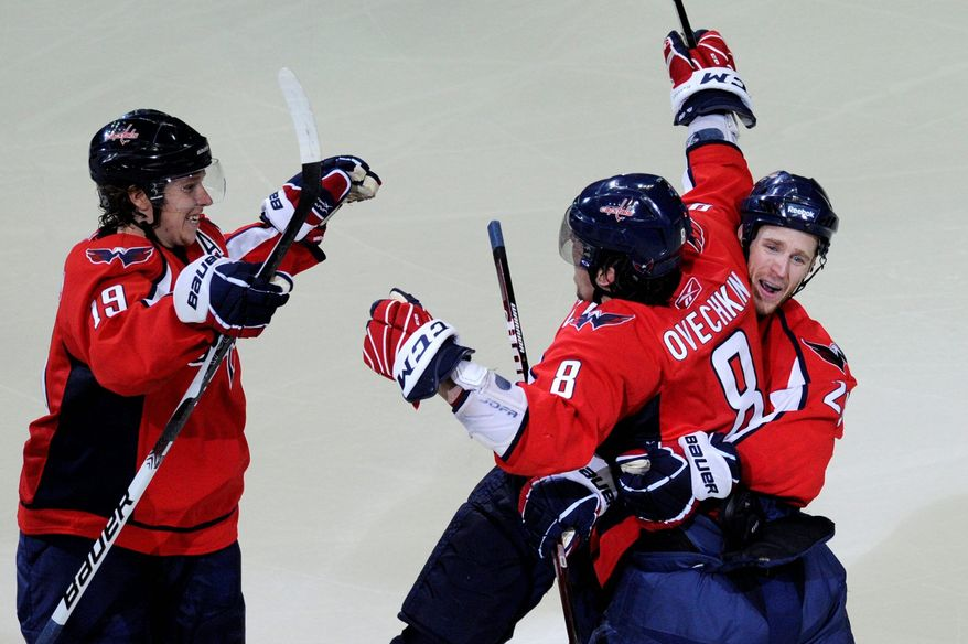 The Capitals' Alex Ovechkin celebrated with Nicklas Backstrom (left) and Brooks Laich after scoring to put Washington up 2-0 against the Rangers on Saturday. (Drew Angerer/The Washington Times)