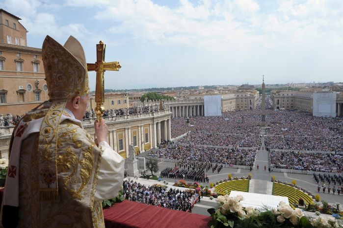 """In this photo provided by the Vatican newspaper L'Osservatore Romano, Pope Benedict XVI holds his pastoral staff Sunday during the """"Urbi et Orbi"""" (Latin for to the City and to the World) message from the balcony of St. Peter's Basilica at the end of the Easter Mass in St. Peter's Square at the Vatican. Benedict XVI urged an end to fighting in Libya, using his Easter Sunday message to call for diplomacy and peace in the Middle East. (Associated Press/L'Osservatore Romano)"""