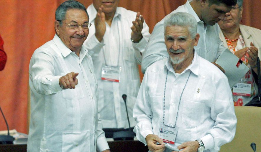 Cuba's President Raul Castro (left) gestures next to Ramiro Valdes, a commander during Cuba's revolution, in Havana. (Associated Press)