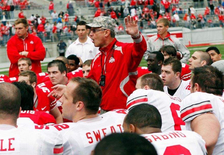 """The NCAA said Ohio State coach Jim Tressel """"failed to deport himself ... [with] honesty and integrity"""" and said he was lying when he filled out a compliance form in September. The case centers on players who traded memorabilia for benefits from a tattoo parlor owner. (Associated Press)"""