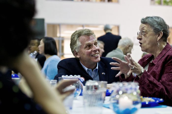 STUMPING?: Once and perhaps future Virginia gubernatorial hopeful Terry McAuliffe chats with Edna Frady at a Falls Church City Democratic Committee fundraising dinner earlier this month. (Drew Angerer/The Washington Times)