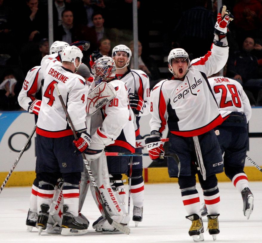 ASSOCIATED PRESS Left wing Alex Ovechkin (8) and Capitals teammates celebrated the overtime goal by Jason Chimera (not pictured) in Game 4 against the New York Rangers. Washington won both games in the series that went longer than regulation time.
