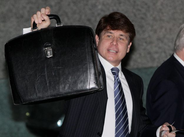 ASSOCIATED PRESS Former Illinois Gov. Rod R. Blagojevich arrives at federal court, briefcase in hand, as jury selection continues in his second corruption trial on Monday in Chicago. Blagojevich, who was convicted of one count in his original trial, faces 20 counts at his second trial.