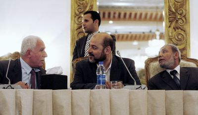 ASSOCIATED PRESS Azzam al-Ahmed, the chief Fatah negotiator in the reconciliation talks (left), sits next to Hamas leaders Moussa Abu Marzoug (center) and Mahmoud Al Zahar (right) in Cairo. Palestinians have reached initial agreement on reuniting their governments in the West Bank and Gaza, a step that, officials say, would remove an obstacle in the way of peace efforts with Israel.
