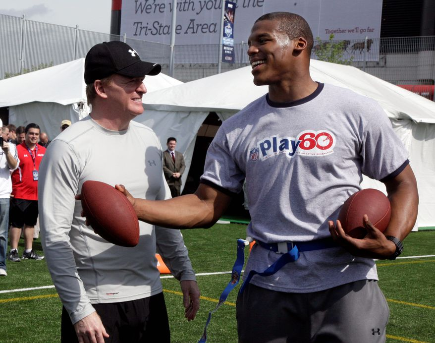 Auburn quarterback Cam Newton (right) shared a moment with NFL commissioner Roger Goodell at an event for youths in New York. Newton has been projected by many to be selectged No. 1 overall by the Carolina Panthers on Thursday night.