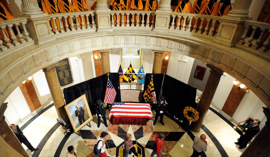 """Members of the public pay their respects to William Donald Schaefer, former Baltimore mayor and former Maryland governor and comptroller, at City Hall in Baltimore on Tuesday, April 26, 2011, as the Baltimore City College High School """"Singing, Swingin' Knights"""" choir performs on the balcony. (AP Photo/Steve Ruark, Pool)"""