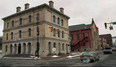 "FILE - A Jan. 26, 2000 file photo shows the exterior of the West Virginia Independence Hall in downtown Wheeling, W.Va. Independence Hall is one of 150 lesser-known destinations The Appalachian Regional Commission is highlighting on a new 13-state map it hopes will get heritage tourists beyond the well-trod battlefields and into ""The Home Front."" (AP Photo/The Wheeling News Register, Scott McCloskey, File)"