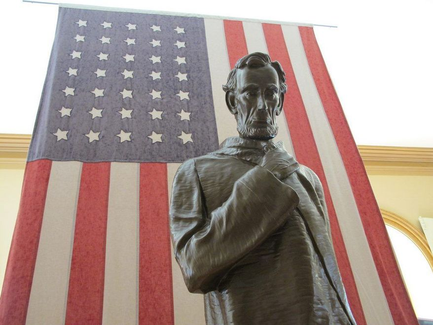 """ASSOCIATED PRESS A copy of Fred Torrey's statue """"Lincoln Walks at Midnight,"""" showing President Lincoln contemplating the prospect of statehood for West Virginia, stands in Independence Hall in Wheeling, W.Va. It is one of the destinations highlighted by the Appalachian Regional Commission on a 13-state map of history."""