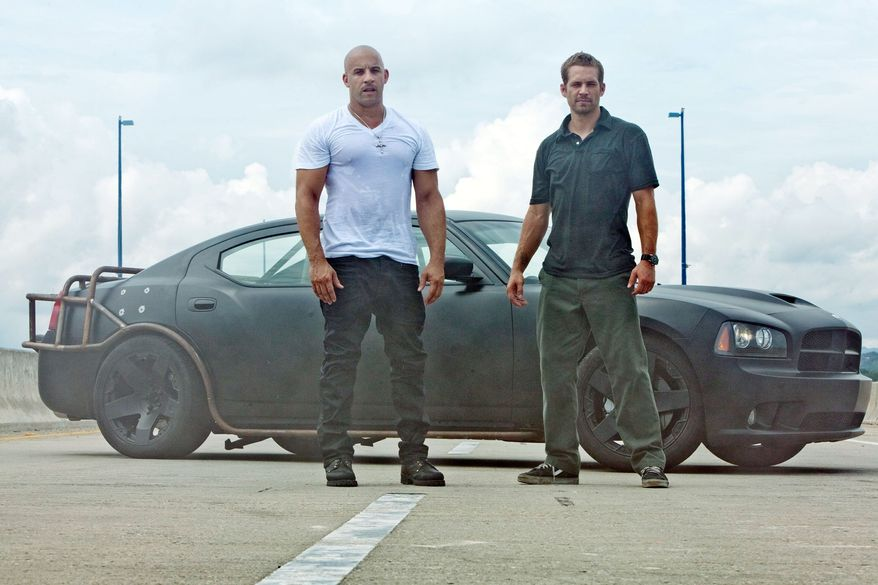 "Vin Diesel (left) and Paul Walker are on the run in Rio de Janeiro in ""Fast Five"" and set up to tangle with a local crime lord while also evading law enforcement."