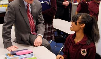 Associated Press Indiana Gov. Mitch Daniels chats with student Cree DeDeaux, 14, during a tour of the Charles A. Tindley Accelerated School in Indianapolis on April 15. Indiana on Wednesday passed the largest school-voucher bill in the nation's history. Mr. Daniels is expected to sign the measure into law.