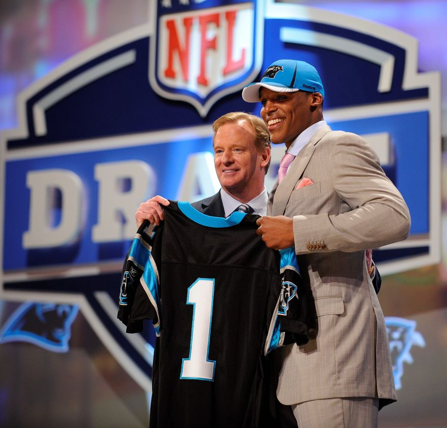Associated Press Auburn Quarterback Cam Newton (right) holds up a jersey with NFL commission Roger Goodell after he was selected as the No. 1 overall pick by the Carolina Panthers in NFL draft in New York.