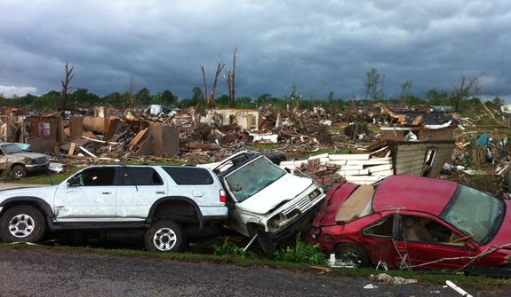 A tornado has flattened Pleasant Grove, Ala., a subdivision of Mountain Grove, Thursday, April 28. 2011. Dozens of tornadoes spawned by a powerful storm system wiped out entire towns across a wide swath of the South, killing at least 194 people, and officials said Thursday they expect the death toll to rise. (AP Photo/Greg Bluestein)