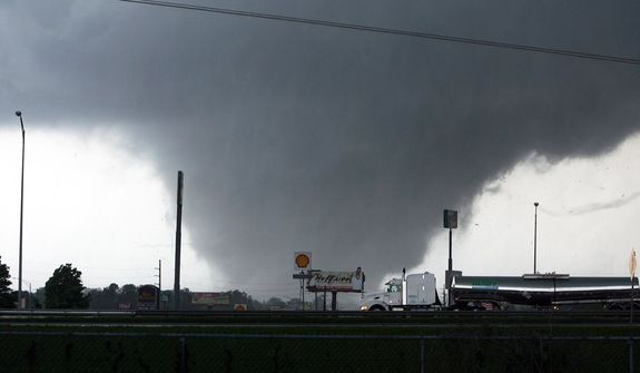 A tornado moves through Tuscaloosa, Ala., on Wednesday, April 27, 2011. A wave of severe storms laced with tornadoes strafed the South on Wednesday, killing at least than 197 people. (AP Photo/The Tuscaloosa News, Dusty Compton)
