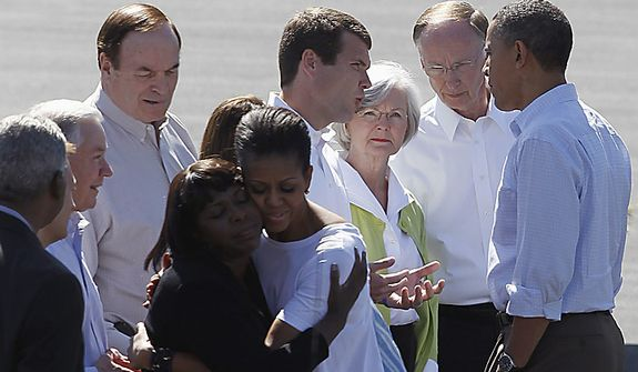 First Lady Michelle Obama hugs Rep. Terri Sewell, D-Ala., as President Barack Obama talks with Tuscaloosa Mayor Walt Maddox, Alabama Gov. Robert Bentley, and his wife Diane Bentley, in Tuscaloosa, Ala., Friday, April 29, 2011, prior to touring tornado damage. Sen. Richard Shelby, R-Ala., is fourth from left, Sen. Jeff Sessions, R-Ala. is third from left. Birmingham, Ala. Mayor William Bell is at left.   (AP Photo/Butch Dill)