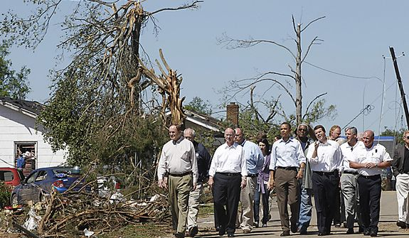 President Barack Obama tours tornado damage with Tuscaloosa, Ala. Mayor Walter Maddox, Alabama Gov. Robert Bentley, third from left, Sen. Richard Shelby, R-Ala., left, and others, Friday, April 29, 2011, Tuscaloosa, Ala. (AP Photo/Charles Dharapak)