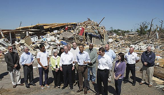 President Barack Obama speaks in Tuscaloosa, Ala., Friday, April 29, 2011, as he, first lady Michelle Obama, and others toured tornado damage. (AP Photo/Charles Dharapak)