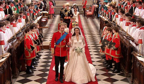 In this image taken from video, Britain's Prince William, left, and his wife, Kate, the Dutchess of Cambridge, walk down the aisle together at Westminster Abbey for the Royal Wedding in London on Friday, April, 29, 2011. (AP Photo/APTN)