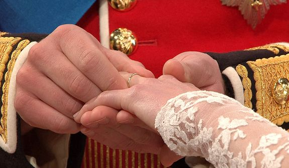 In this image taken from video, Britain's Prince William, left, places the ring on the finger of his bride, Kate Middleton, as they stand at the altar at Westminster Abbey for the Royal Wedding in London on Friday, April, 29, 2011. (AP Photo/APTN)