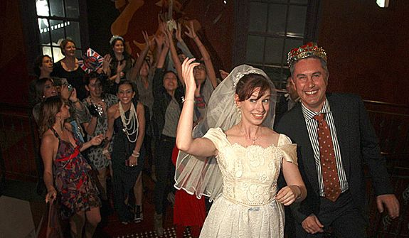 Dressed as bride and groom, Linzi Aland, center, and Nick Volker, right, do a pretend bouquet  toss during a royal wedding party at the Ancient Britain (the AB) hotel in Sydney, Australia, Friday, April 29, 2011. The hotel is hosting the party during celebrations for the wedding of Prince William and Kate Middleton. (AP Photo/Rob Griffith)