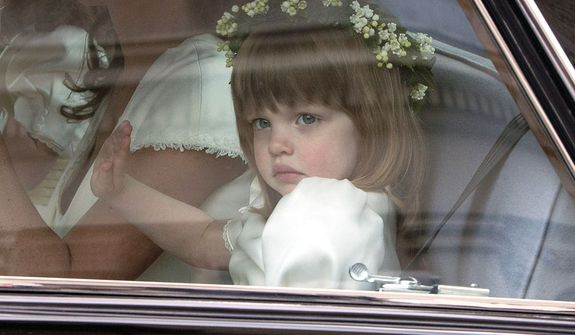 Bridesmaid Eliza Lopes, the granddaughter of the Duchess of Cornwall, leaves the Goring Hotel as they make their way to Westminster Abbey ahead of the Royal Wedding between Britain's Prince William and Kate Middleton, London, Friday, April, 29, 2011. (AP Photo/Joel Ryan, Pool)