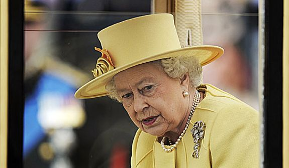 Britain's Queen Elizabeth II looks out of her carriage outside Westminster Abbey after the Royal Wedding for Britain's Prince William and his wife Kate, Duchess of Cambridge in London Friday, April, 29, 2011. (AP Photo/Martin Meissner)
