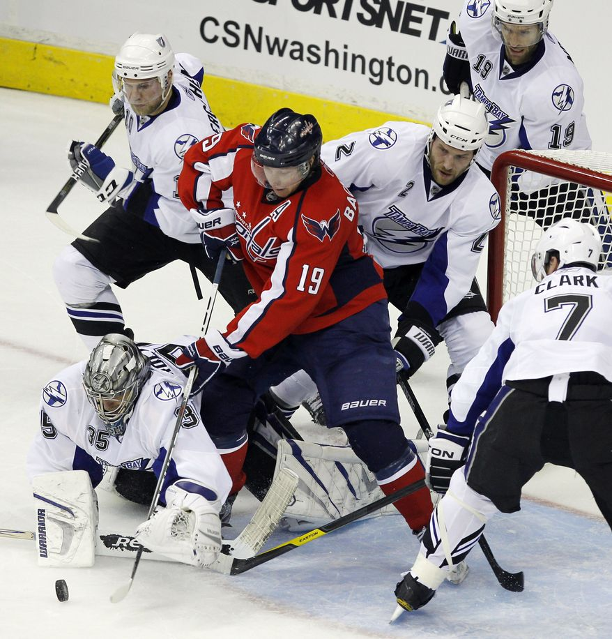 Tampa Bay Lightning goalie Dwayne Roloson (35), with Eric Brewer (2), Brett Clark (7), Dominic Moore (19), Sean Bergenheim (10) from Finland, work against Washington Capitals center Nicklas Backstrom from Sweden, during the second period in Game 1 of a conference semifinal NHL Stanley Cup hockey playoff series Friday, April 29, 2011 in Washington.(AP Photo/Alex Brandon)