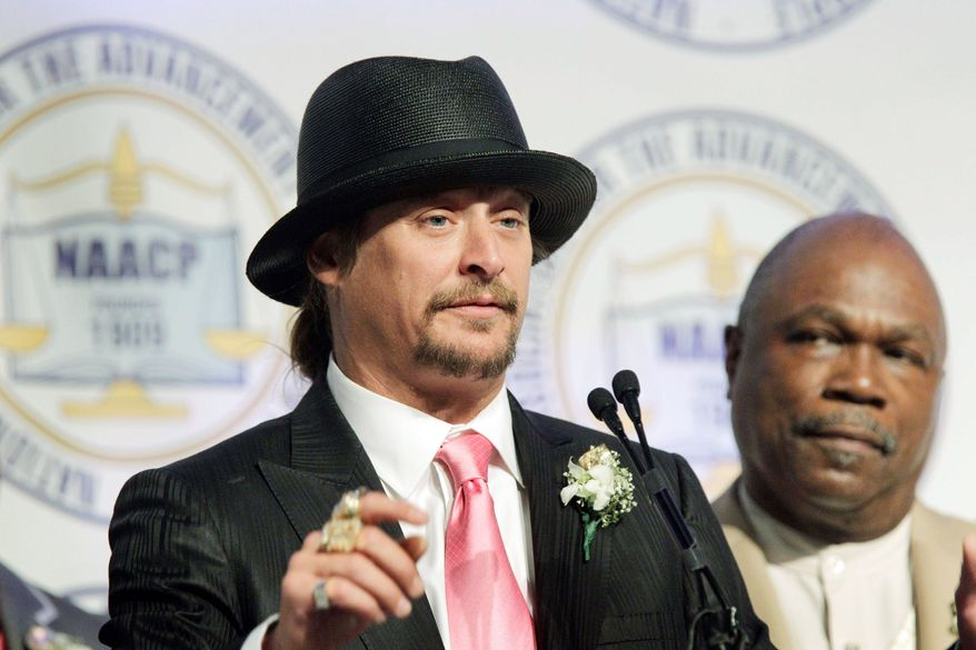 Associated Press Kid Rock addresses the audience at the Detroit NAACP's annual fundraising dinner Sunday, as chapter President Wendell Anthony looks. The musician was honored for his support of the city.