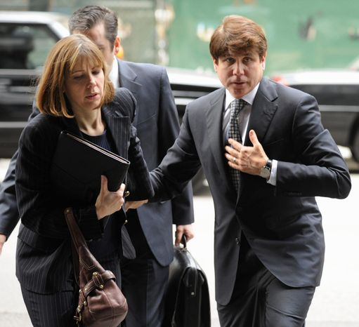 Ousted Illinois Gov. Rod R. Blagojevich and his wife, Patti, arrive at federal court in Chicago for final jury selection and opening arguments in his second corruption trial. Blagojevich, convicted in his original trial on one count of lying to the FBI, faces 20 counts this time. (Associated Press)