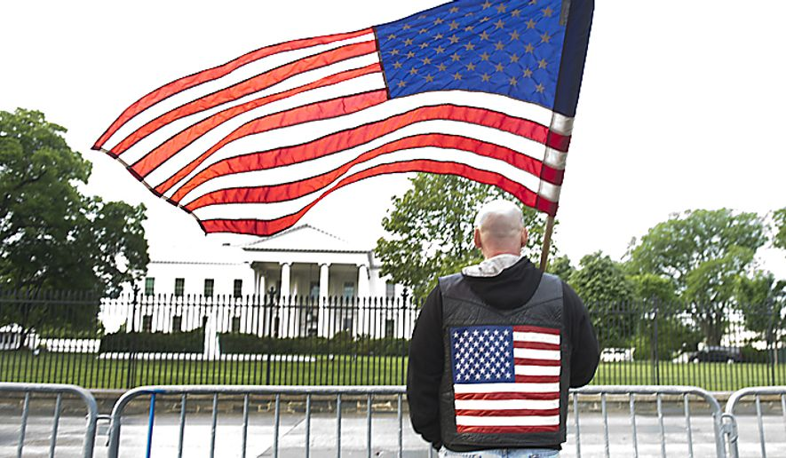 """""""I'm just a proud American and wanted to come down here and stand in front of the White House and wave my flag,"""" says Danny Parker of Shamokin, Pa., who drove to Washington, D.C., Sunday night after hearing the news that Osama Bin Laden was killed. He arrived in the nation's capital Monday at 5 a.m., and spent the morning standing in front of the White House in Lafayette Park. (Barbara L. Salisbury/The Washington Times) ** FILE **"""
