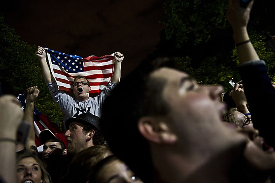 Crowds gather and celebrate outside the White House in Washington early Monday, May 2, 2011, after President Barack Obama announced the death of Osama bin Laden. (Drew Angerer/The Washington Times)