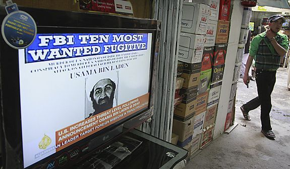 An Afghan youth walks past by a television  announces the death of Al-Qaida leader Osama bin Laden at a television selling market in Kabul, Afghanistan on Monday, May 2, 2011. Bin Laden, the glowering mastermind behind the Sept. 11, 2001, terror attacks that killed thousands of people, was slain in his hideout in Pakistan early Monday in a firefight with U.S. forces, ending a manhunt that spanned a frustrating decade.(AP Photo/Musadeq Sadeq)