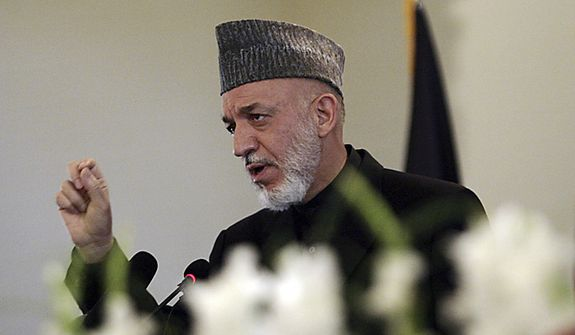 Afghan President Hamid Karzai speaks during a district assembly gathering at the presidential palace in Kabul, Afghanistan Monday, May 2, 2011. Afghanistan's president lauded Osama bin Laden's death as a serious blow to terrorism Monday and argued that the strike in Pakistan proves the real fight against terrorists is outside his country's borders. (AP Photo/Hossein Fatemi)